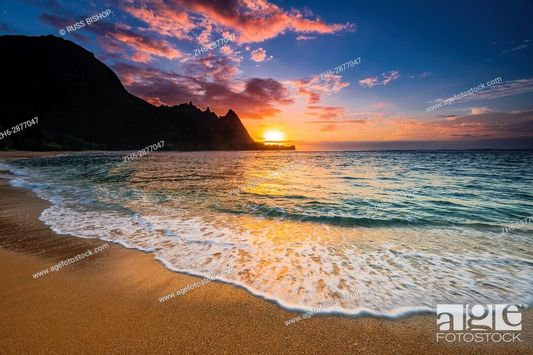Stock Photo: Sunset over the Na Pali Coast from Tunnels Beach, Haena State Park, Kauai, Hawaii USA.