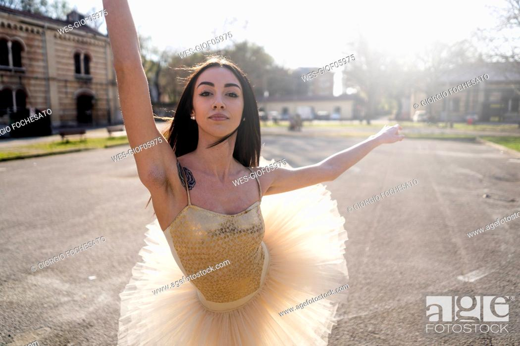 Stock Photo: Italy, Verona, portrait of Ballerina dancing in the city.