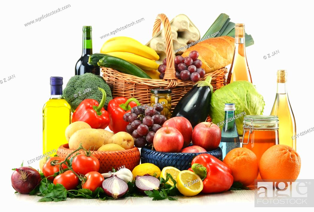 Stock Photo: Composition with groceries and basket isolated on white.