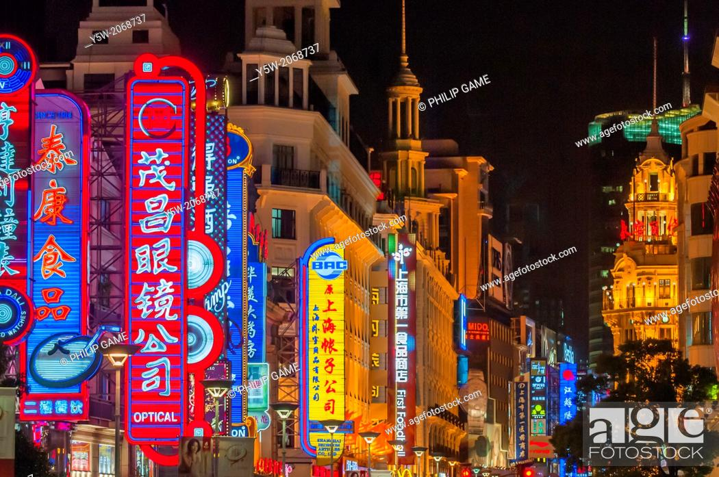 Stock Photo: Nanjing Dong Lu shopping strip at night, Shanghai.