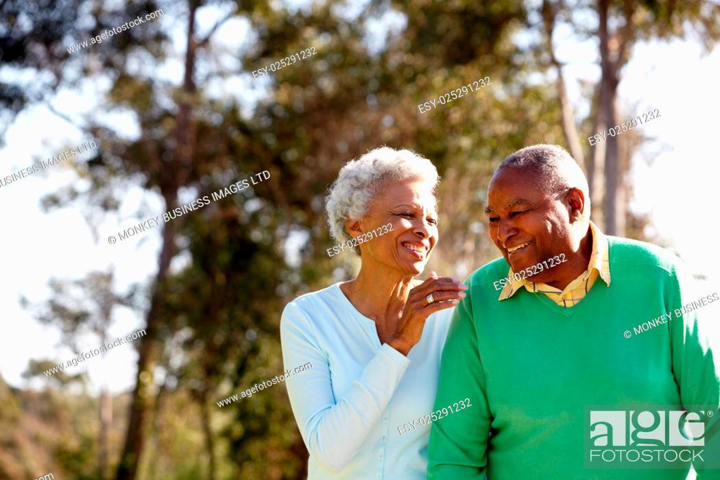 Stock Photo: Senior Couple Enjoying Walk Together.