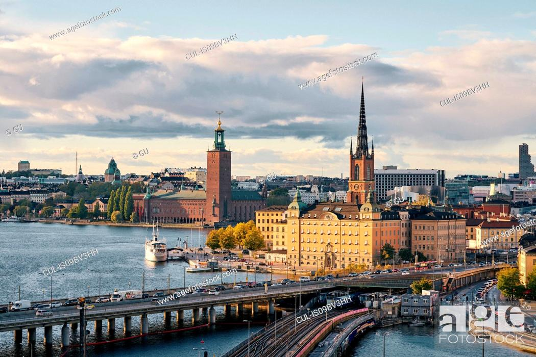 Stock Photo: Bridges, railway tracks, church tower, cityscape and water canal, Stockholm, Sweden.