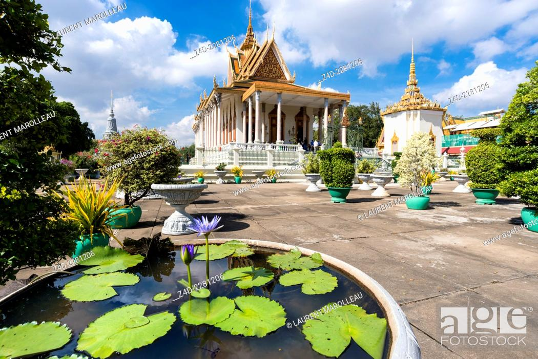 Stock Photo: Blue Egyptian Water Lily or Sacred Blue Lily (Nymphaea caerulea) and Silver Pagoda. The Silver Pagoda's proper name is Wat Preah Keo Morokat.