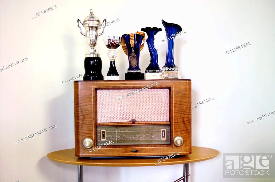 Stock Photo: Old radio set and trophies.