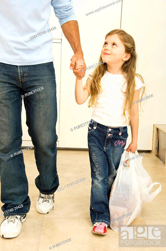 Stock Photo: Girl walking with her father.