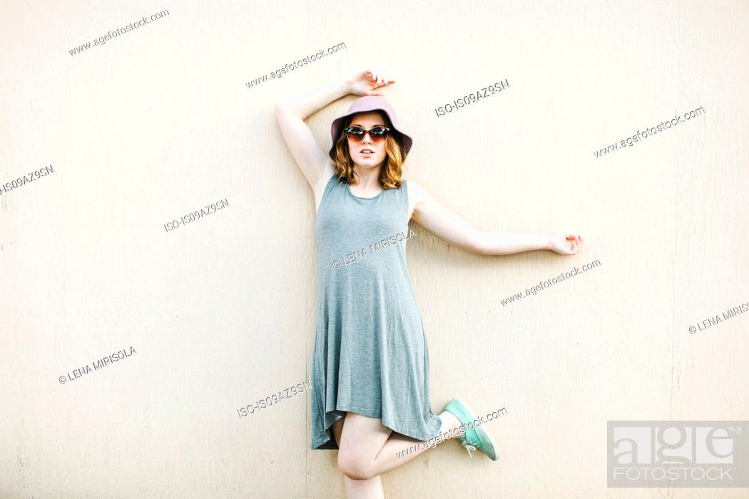 Stock Photo: Woman standing on one leg looking at camera.