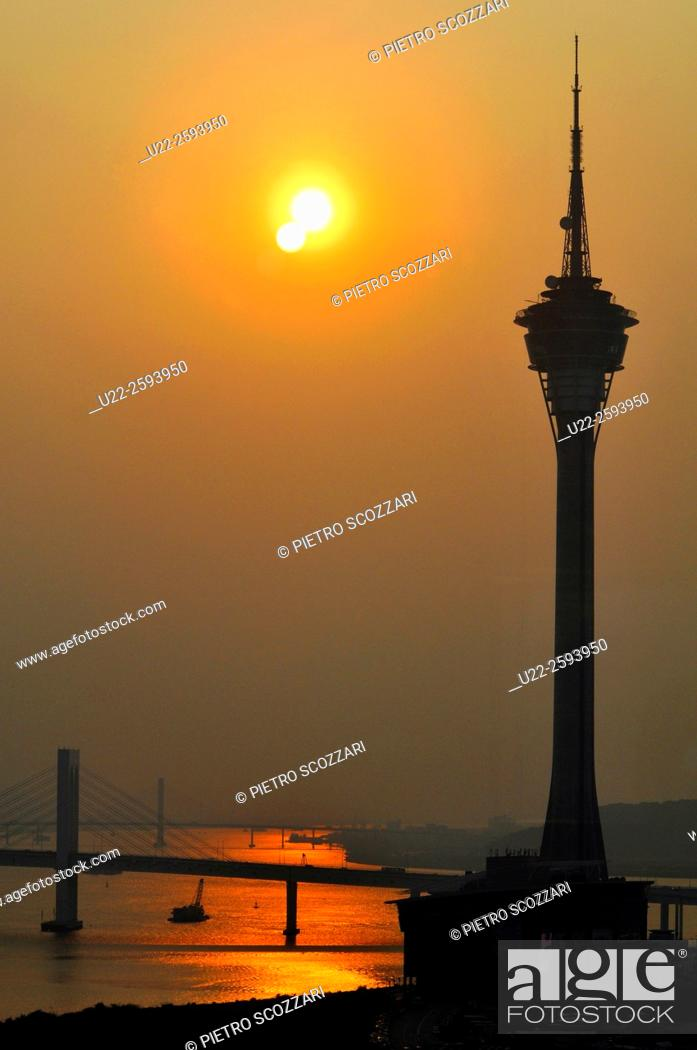 Stock Photo: Asia, China, Macao, the Macao Tower by the Pearl River at sunset.