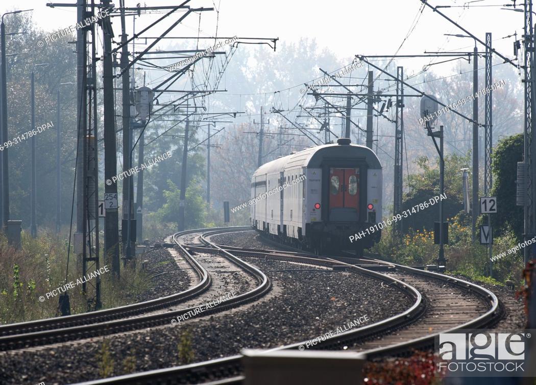 Stock Photo: 15 October 2019, Poland, Küstrin (kostrzyn): An intercity of the Polish state railway PKP leaves the city. Photo: Soeren Stache/dpa-Zentralbild/ZB.