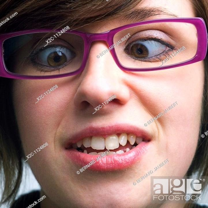 Stock Photo: Young woman pulling a face.