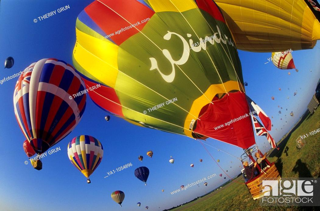 Stock Photo: Wide view of hot air balloons take off. Mondial air balloon festival, largest one in Europe. Chambley, Lorraine, France. Europe.