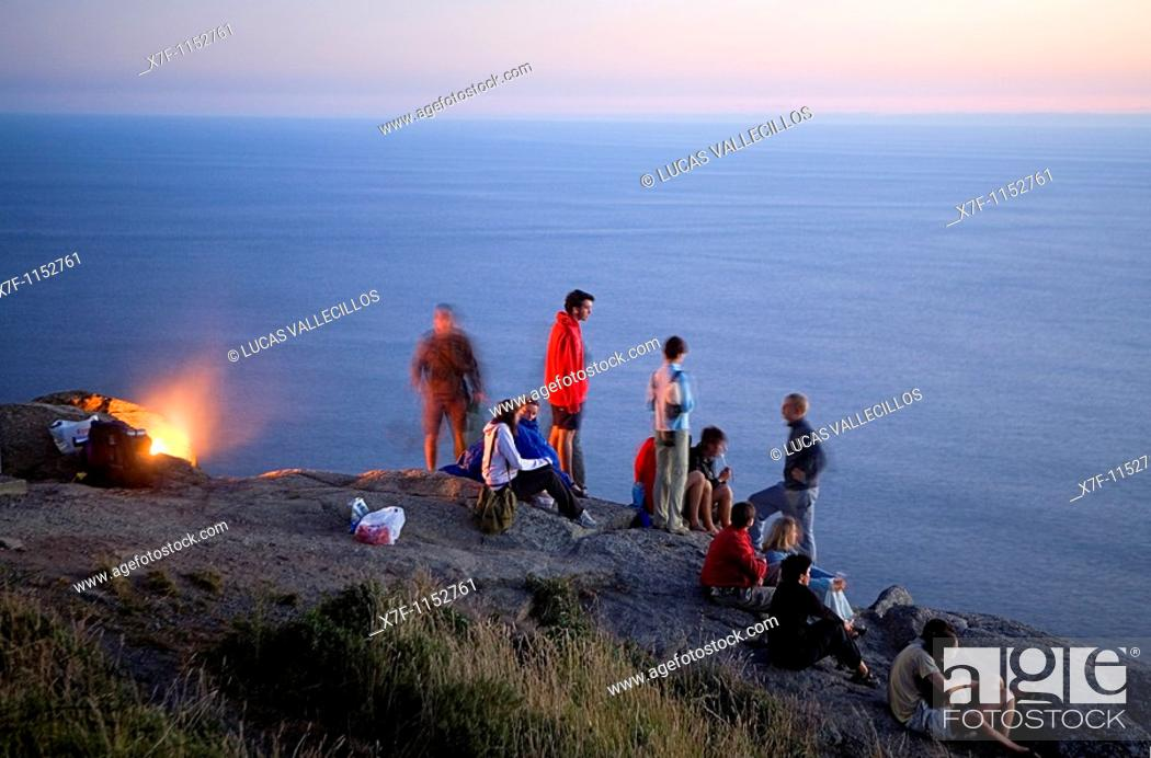 Stock Photo: Pilgrims in Cape Finisterre  At left the pilgrims burn the clothes used during the peregrination to Santiago de Compostela  Finisterre Coruña province Spain.