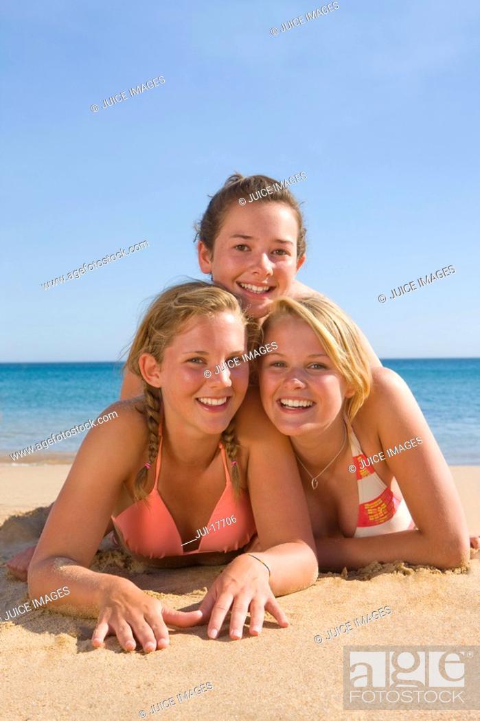Stock Photo: Teenage girls posing on beach.