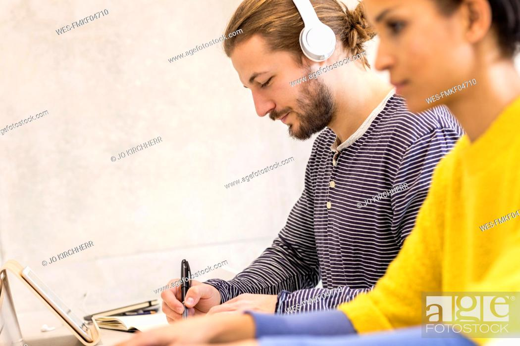 Stock Photo: Young students at work.
