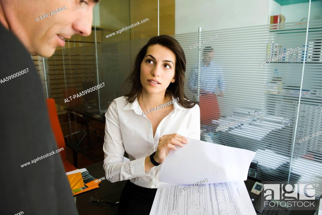 Stock Photo: Executive reviewing document with colleague.