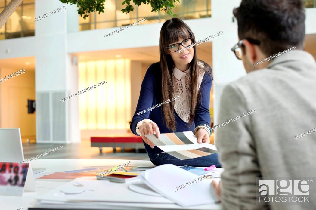 Stock Photo: Fashion designers discussing in an office.