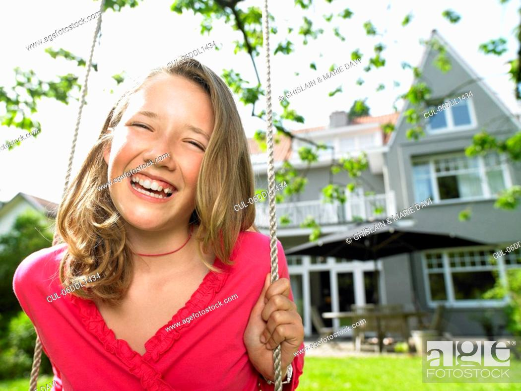 Stock Photo: Girl on a swing smiling.