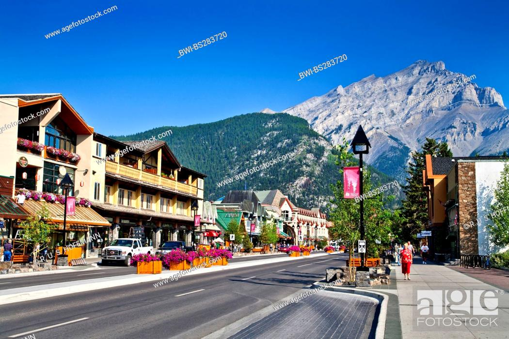 Stock Photo: view through the main street in front of a picturesque mountain range with the Cascade Mountain, Canada, Alberta, Banff National Park, Banff.