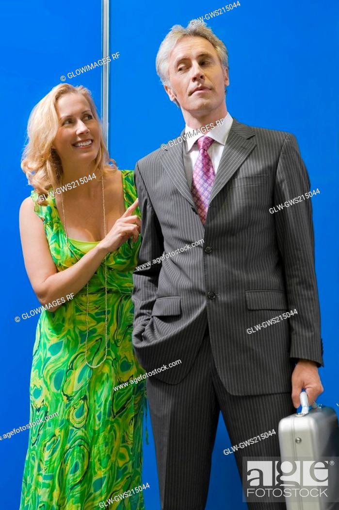 Stock Photo: Mature couple standing in an elevator.