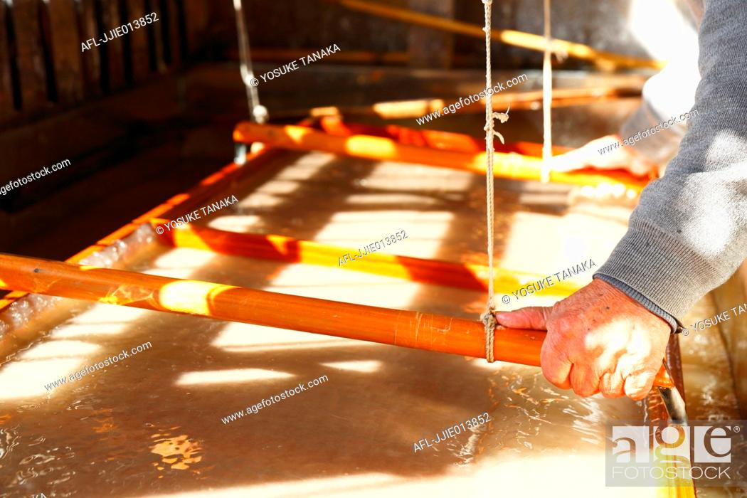 Stock Photo: Japanese traditional paper craftsman working in his studio.