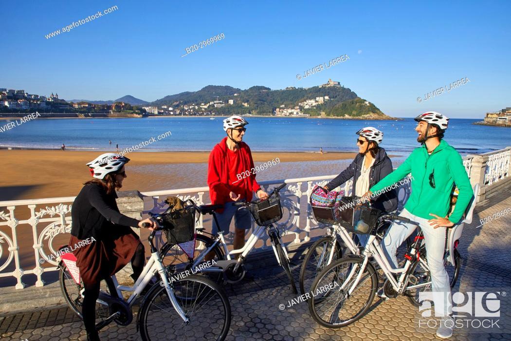 Stock Photo: Group of tourists and guide making a bicycle tour through the city, La Concha Bay, Donostia, San Sebastian, Gipuzkoa, Basque Country, Spain, Europe.