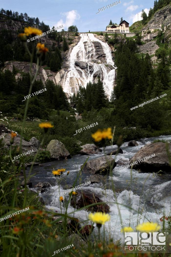 Stock Photo: A house at the top of a waterfall, Val Formazza, Piedmont, Italy.