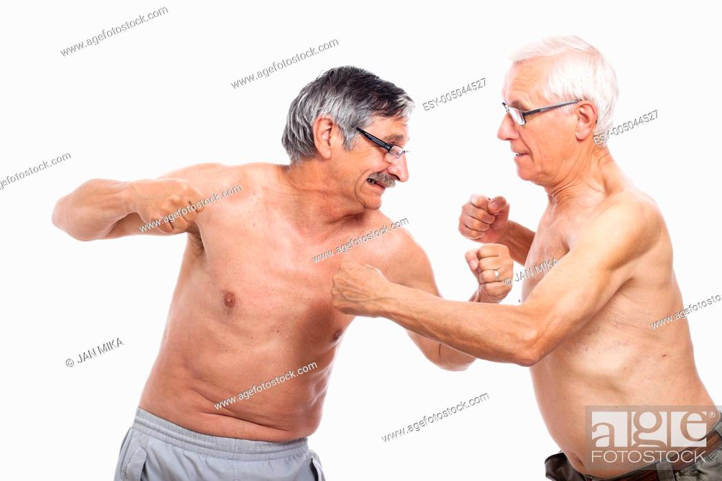 Stock Photo: Two naked senior men fighting, isolated on white background.