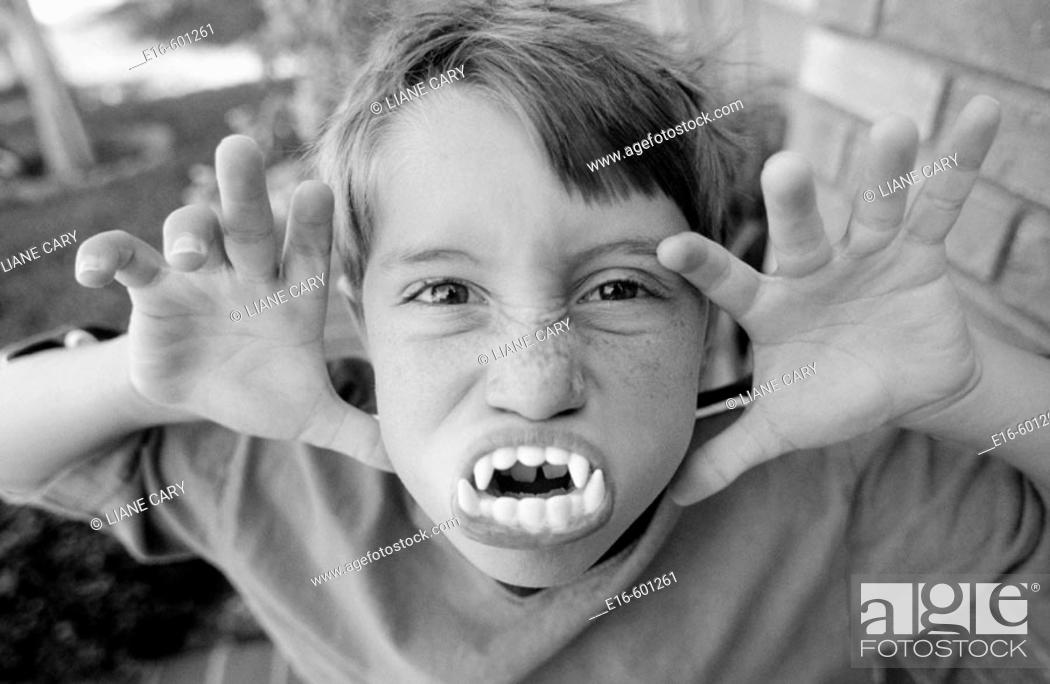 Stock Photo: Boy with pretend monster teeth.