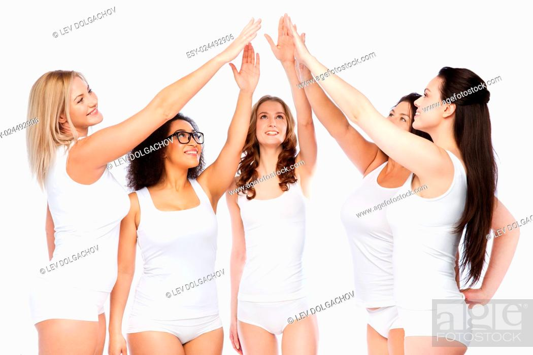 Stock Photo: gesture, friendship, beauty, body positive and people concept - group of happy different women in white underwear making high five.