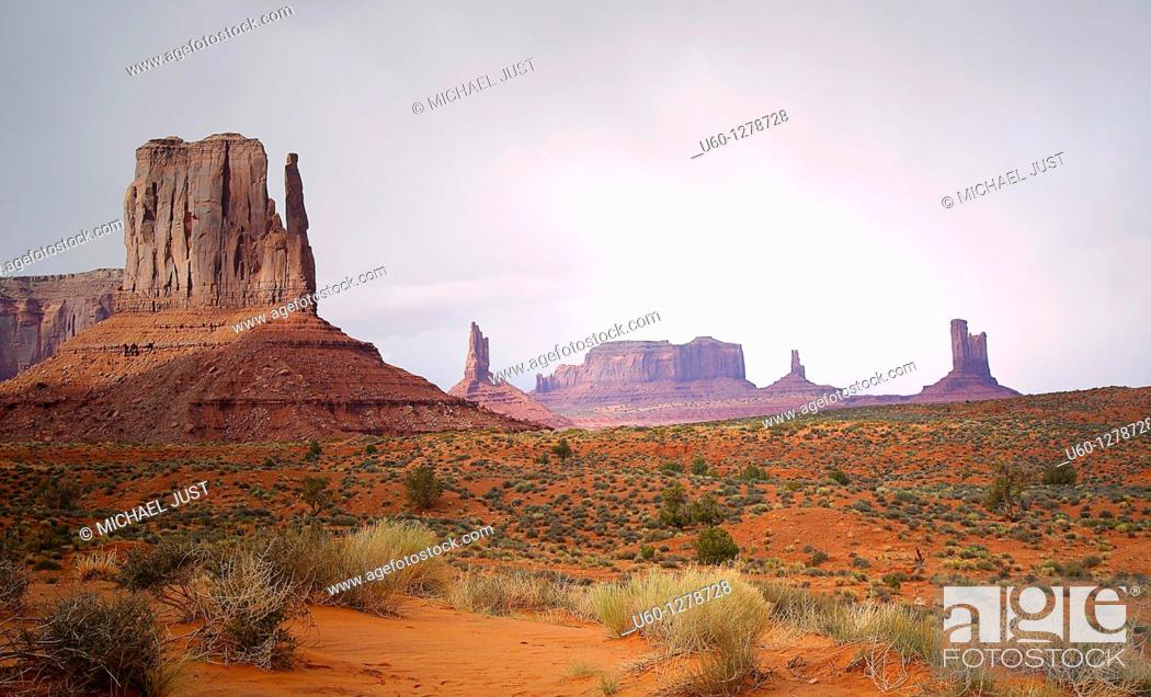 Stock Photo: A setting sun provides soft light to the landscape at Monument Valley, Arizona.