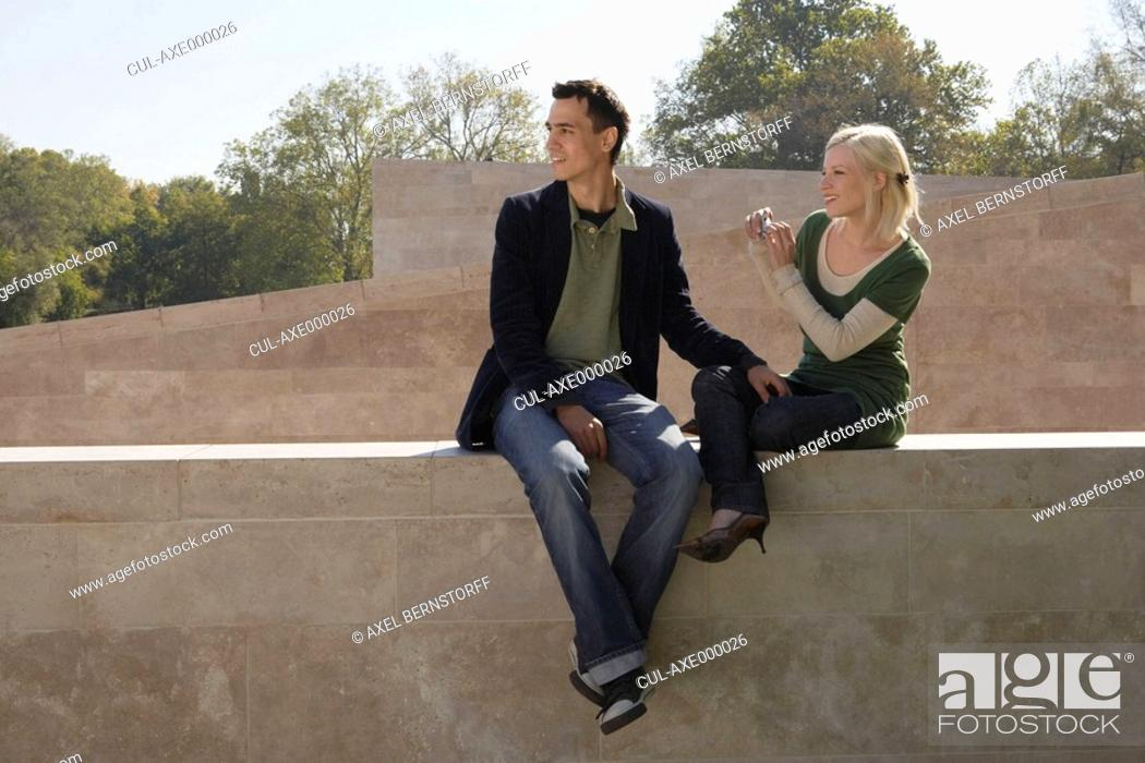 Stock Photo: Couple taking a picture outdoors smiling.