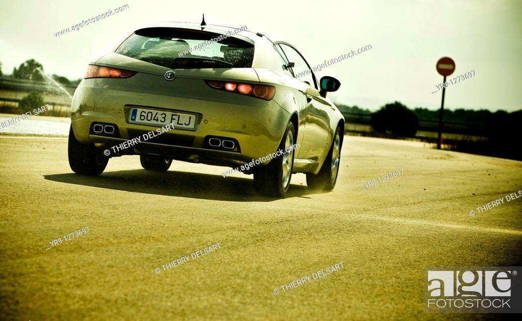 Stock Photo: Emergency braking before entering the wrong way lane. Car: Alfa Romeo Brera.