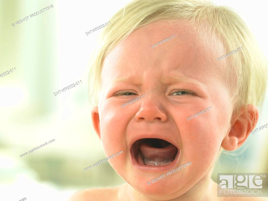 Stock Photo: Baby's face close up crying.