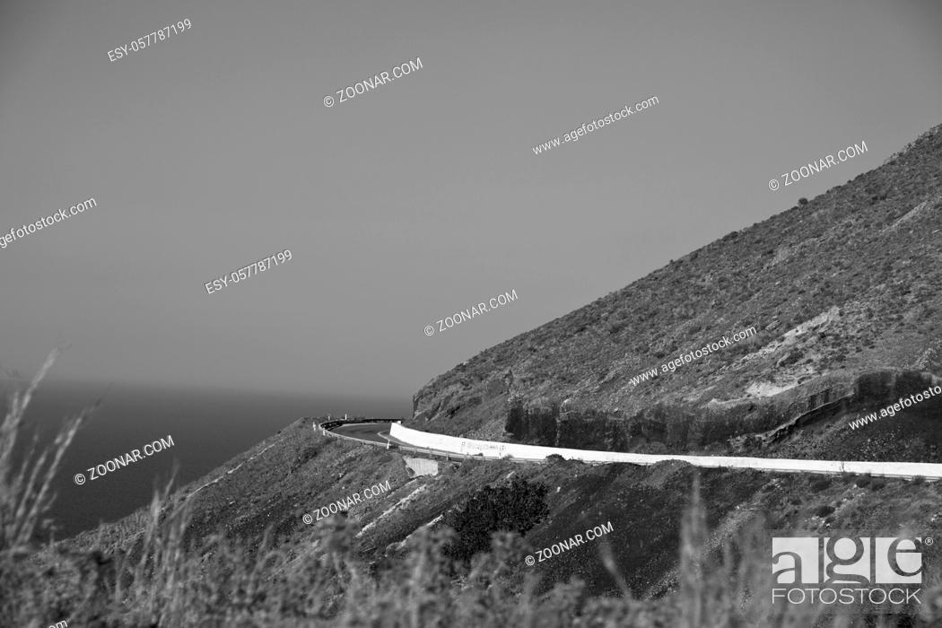 Imagen: santorini europe greece and dry bush rock alone in the sky.