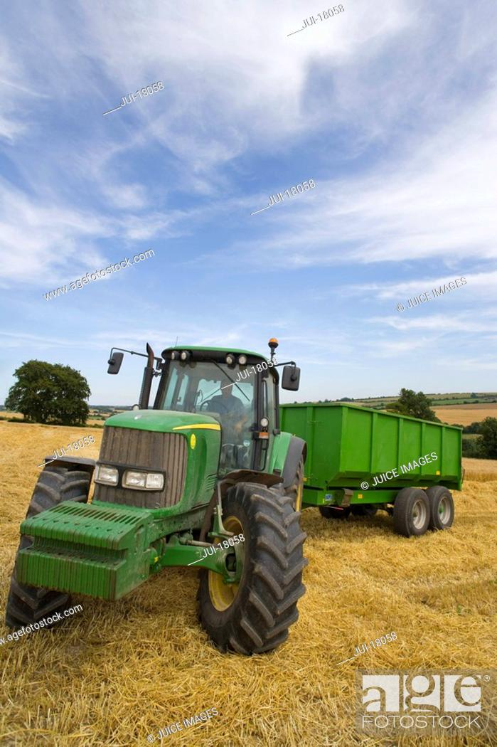 Stock Photo: Tractor in barley field.