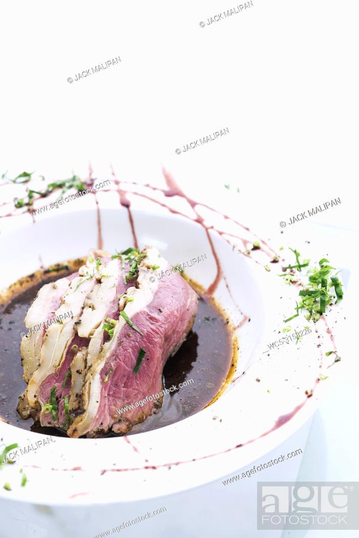 Imagen: Roast beef modern fusion gourmet food cuisine meal with gravy.