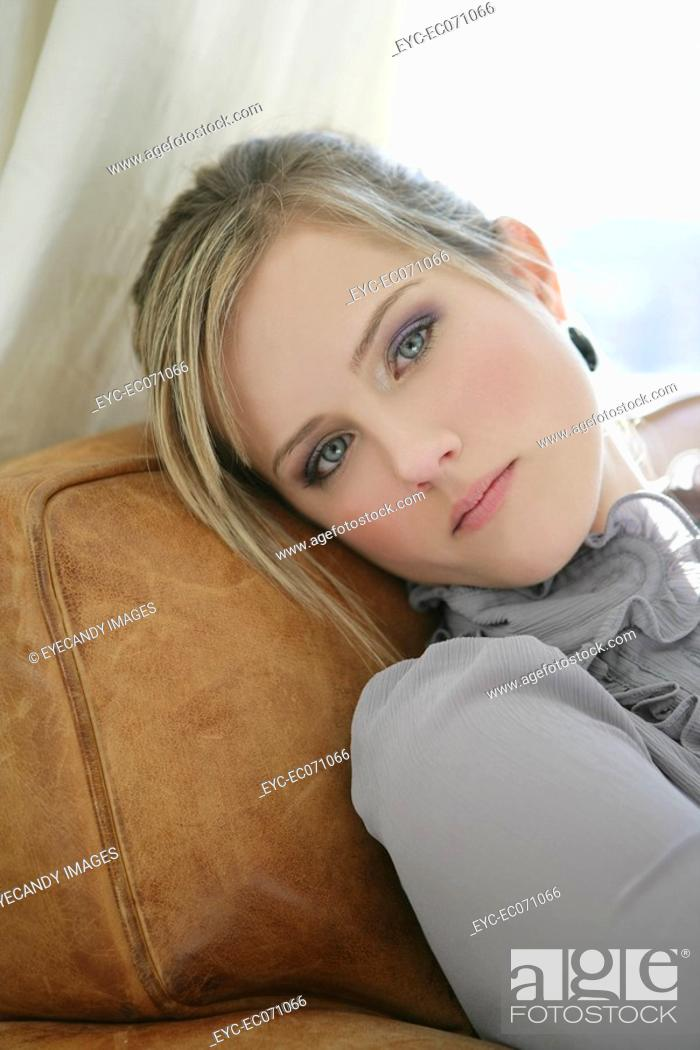 Stock Photo: Portrait of young woman relaxing.