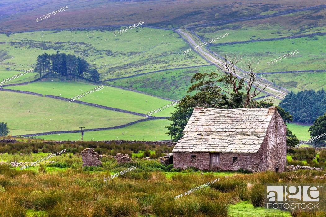 Stock Photo: Derelict farmhouse and barn in moorland.