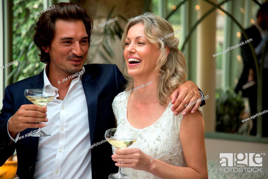 Stock Photo: Newlyweds at wedding reception.