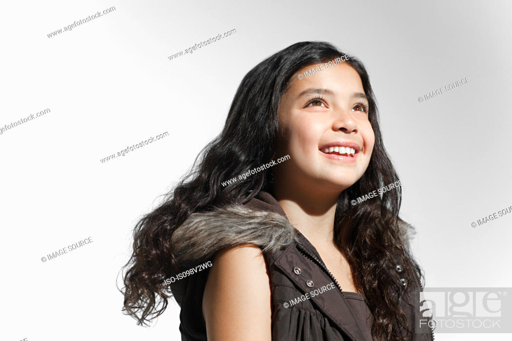 Stock Photo: Girl looking up and smiling.