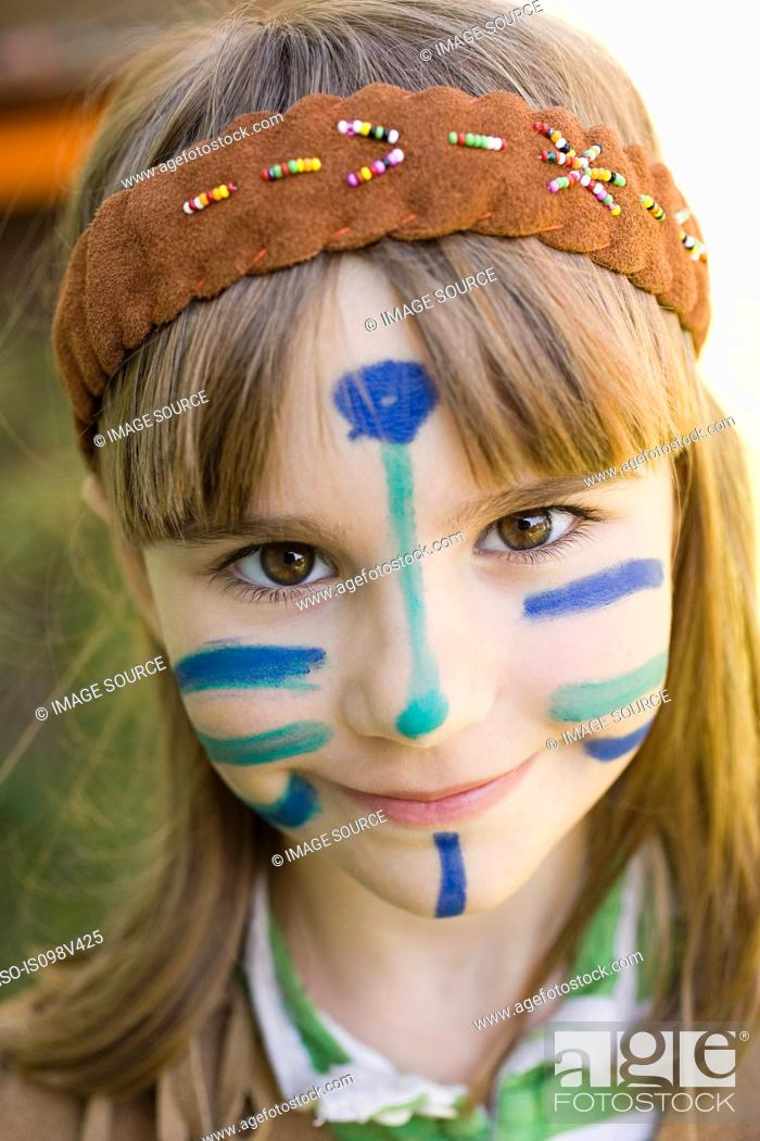 Stock Photo: Girl dressed in Native American costume with face painted.