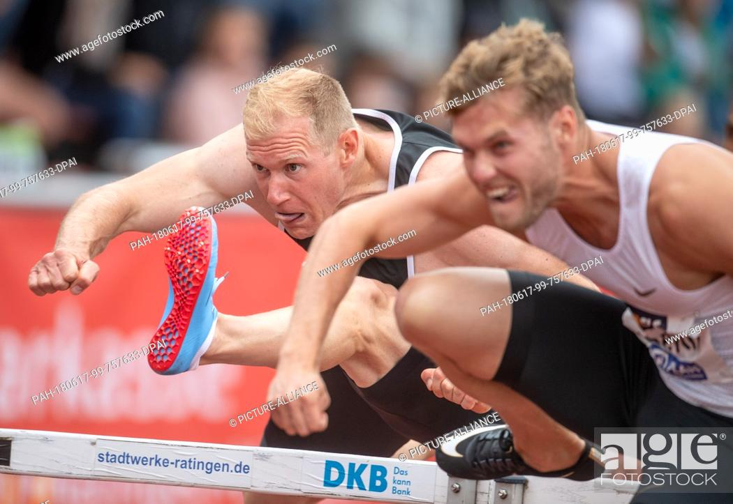 Stock Photo: 17 June 2018, Germany, Ratingen: Athletics: Mehrkampf-Meeting. Decathlon athletes Arthur Abele (L) of Germany and Kevin Mayer of France in action during the 110.