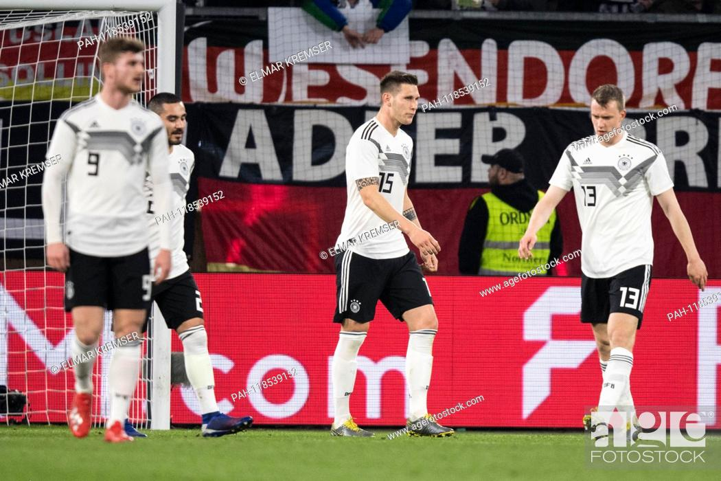 Stock Photo: Fltr Timo WERNER (GER), Ilkay GUENDOGAN (Gvºndogan, GER), Niklas SUELE (Svºle, GER), Lukas KLOSTERMANN (GER) are disappointed after the goal to 1-0 for Serbia.