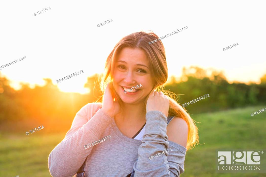 Stock Photo: beautiful portrait of a carefree friendly approachable girl with a stunning smile and cute looks.