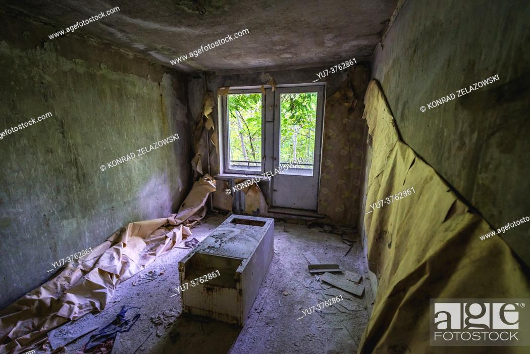 Stock Photo: Room in abandoned block of flats in Chernobyl-2 military base, Chernobyl Nuclear Power Plant Zone of Alienation in Ukraine.