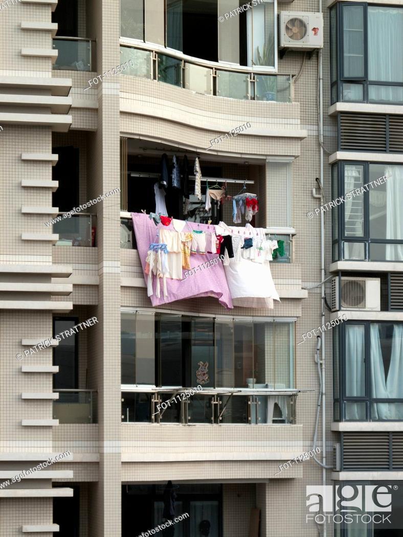 Stock Photo: Laundry hanging from a balcony, Xiamen, China.