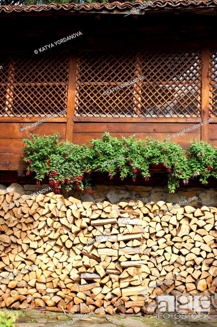 Stock Photo: Stacked of split firewood.