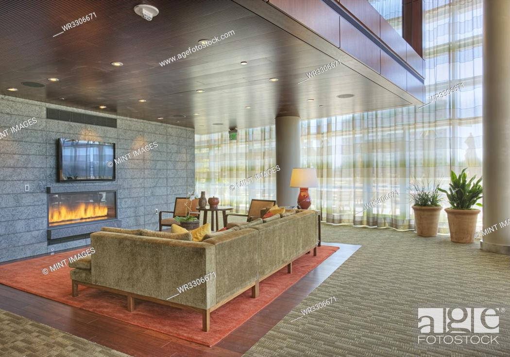 Photo de stock: Sofa and fireplace in lobby.