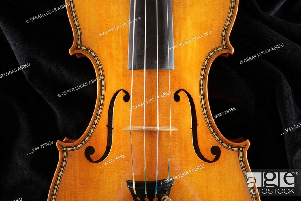 Stock Photo: Violin in Stradivarius style made by luthier Fernando Solar Garcia nd preserved in the Royal Palace, Madrid, Spain.