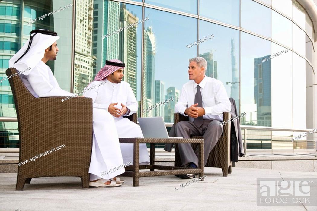 Stock Photo: Businessmen having a meeting.