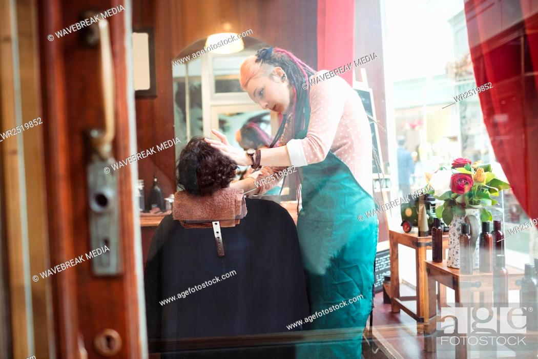 Stock Photo: Man getting his beard shaved.